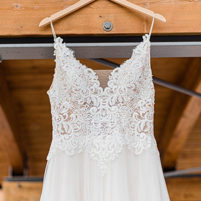 Wedding dress hanging on hanger