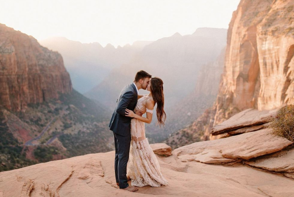 Man and woman getting married in mountains elopement husband and wife