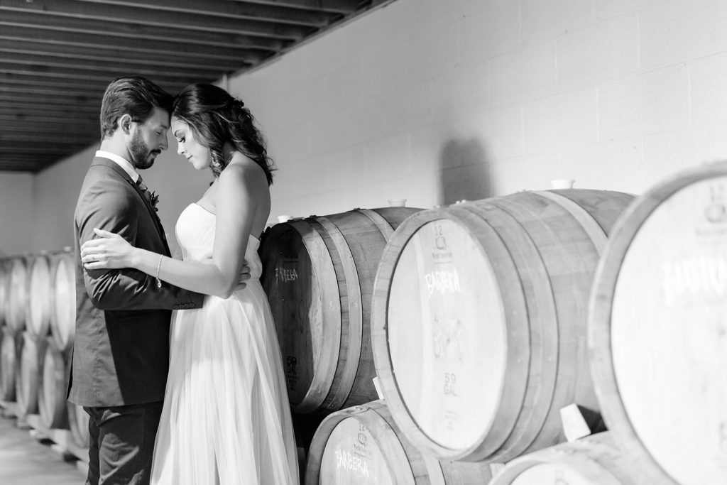 Winery wedding with tulle wedding gown and suite and wine barrels