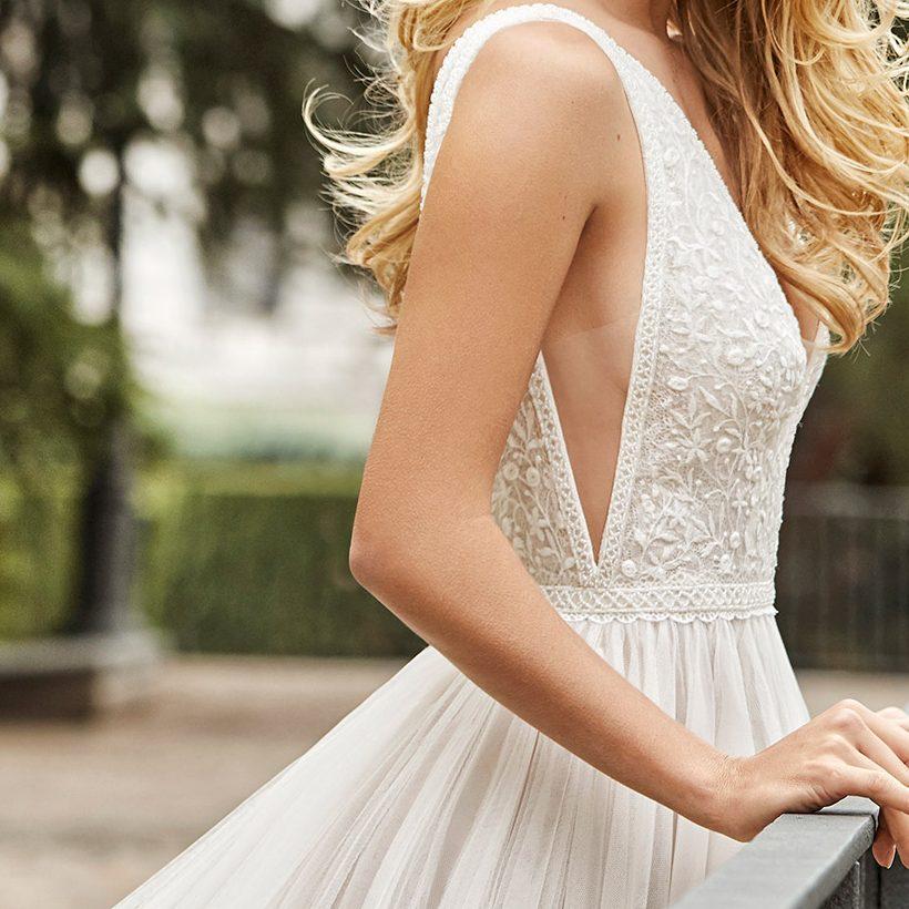 Woman in wedding dress on a bridge