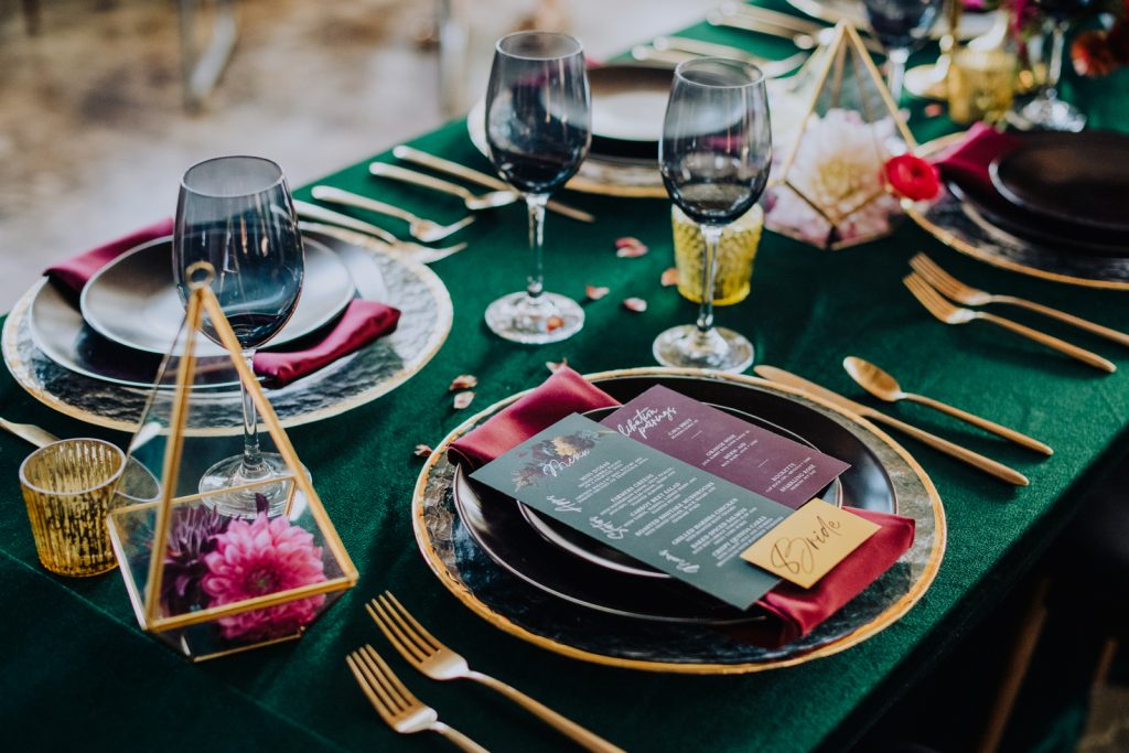 Wedding tables with plates, silverware, glassware, and menu