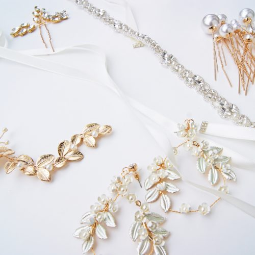 Gold jewelry pieces with a white background
