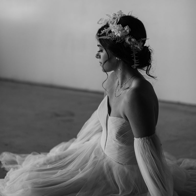 Woman in tulle wedding dress with floral crown black and white