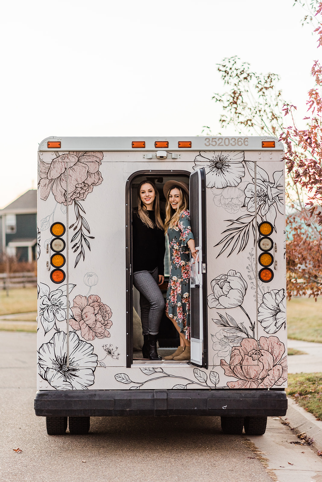 Two girls in a pink floral bridal truck