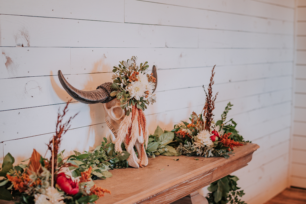 A boho cow skull decorated with floral