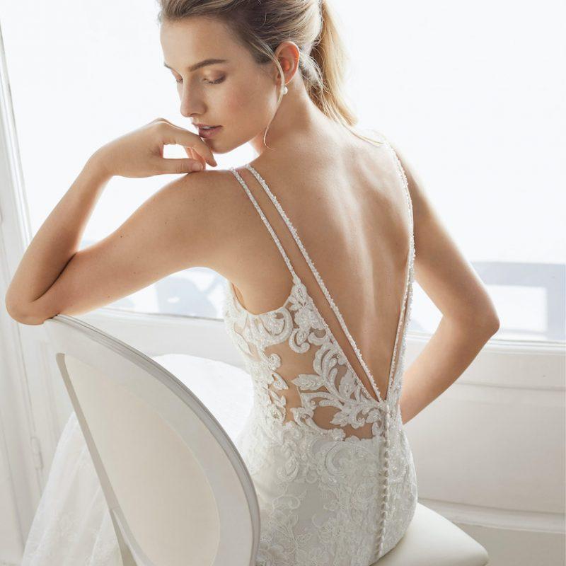 Women sitting in backless wedding dress
