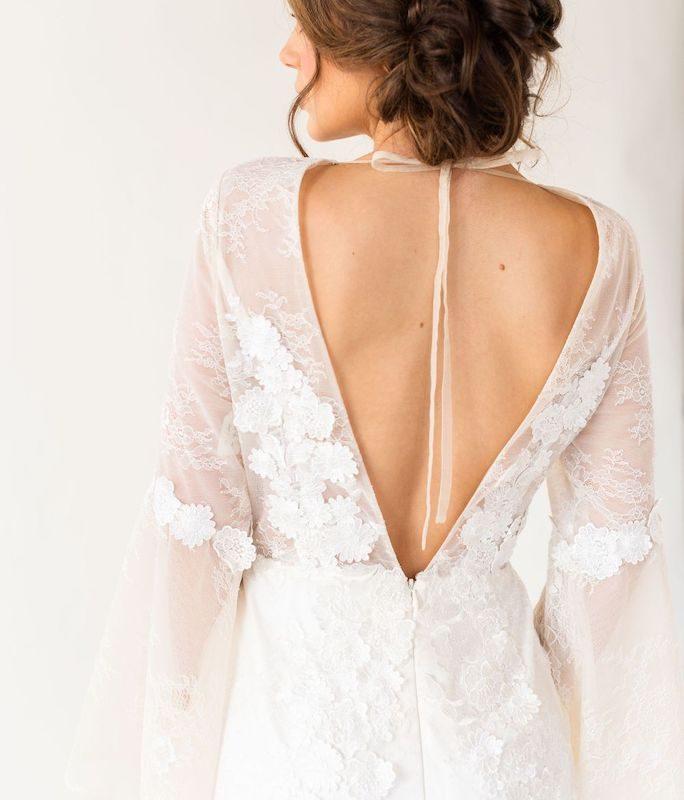 Back of bride posing in boho wedding dress