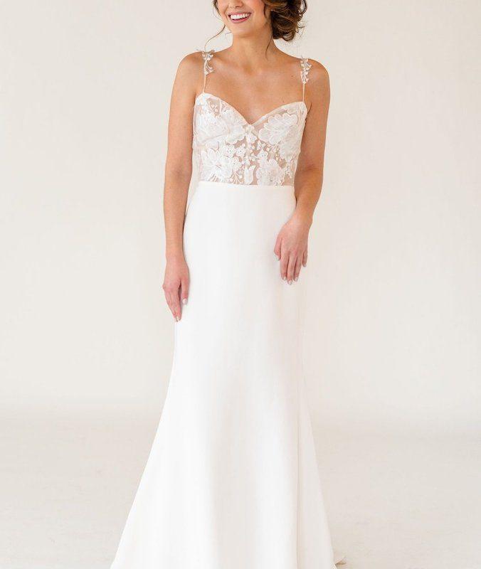 Model posing in lace crepe wedding dress