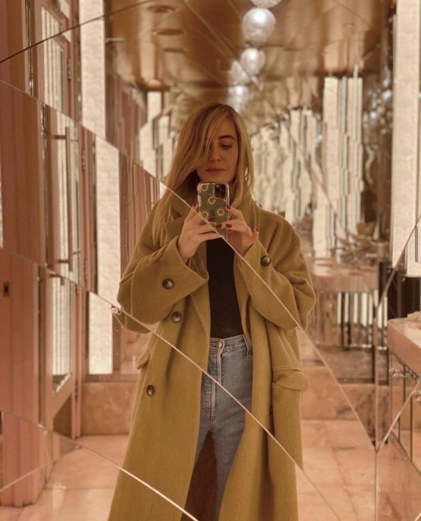 Designer Charlie Brear taking a mirror selfie.